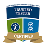 """The home page shows a photo of a visually challenged woman operating a computer, wearing headphones around her neck. Another woman stands beside her. Scrolling down the page shows 4 logos. The first logo is a certification of the Trusted Tester. The logo has a shield-like structure and is divided into 4 sections. The top section is in curved rectangle shape with the text, Trusted tester, written in two lines. On top of this section lies the text, Department of Homeland Security. Below this, are 2 disjoint squares placed adjacent to each other and with lines slightly curved. On the left square is an icon of a person's outline and on the right are two checkboxes with tick marks placed one below the other. The fourth section of the logo is rectangular in shape and appears as if placed on top of a stand. On the rectangle, the text """"CERTIFIED"""" is written in upper case. The second logo is the logo of I S O 9001. The logo shows an octagon with the text, T U V, S U D, I S O 9001. The third logo is the logo of I S O 27001. The logo shows an octagon with the text, T U V, S U D, I S O 27001. The fourth logo is a logo of the Benetech certificate of accessible vendor. The logo is in concentric circles. The center portion of the logo is an abstract image of a whirling motion. The text """"Accessible Vendor"""" appears in a curved fashion in the upper half of the logo and the text, Benetech Certified appears in the lower half, again in a curved fashion."""